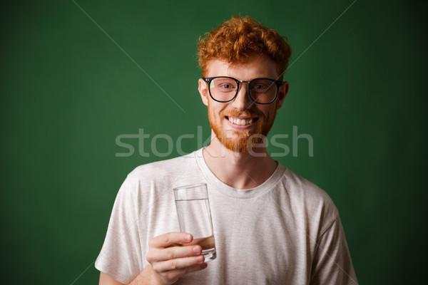 Barbuto uomo occhiali vetro acqua Foto d'archivio © deandrobot
