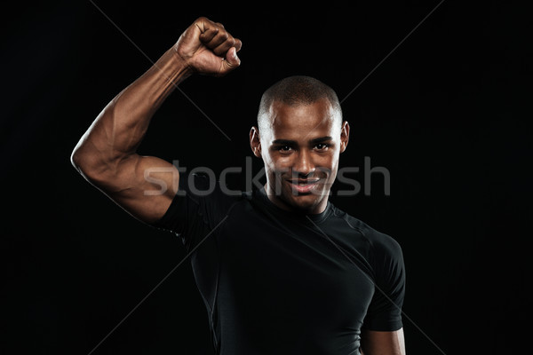 Young happy afro american sports man celebrating his victory wit Stock photo © deandrobot