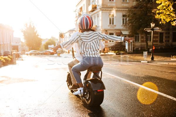 вид сзади счастливым африканских пару современных мотоцикле Сток-фото © deandrobot