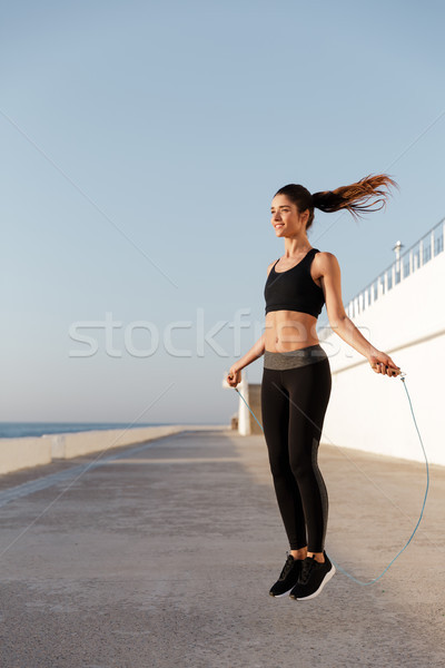 Gorgeous young happy sports woman make sport exercises Stock photo © deandrobot