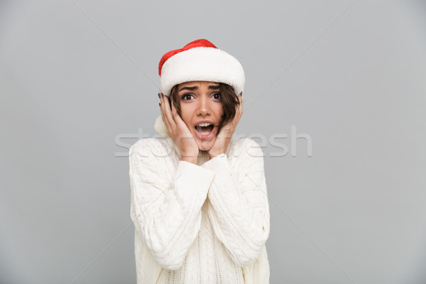 Portrait of a frustrated upset girl in christmas hat screaming Stock photo © deandrobot
