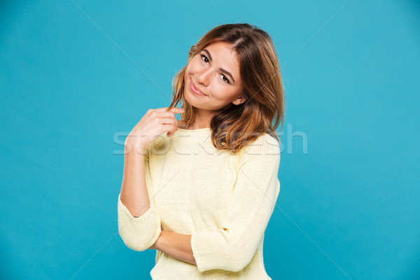 Pleased woman in sweater looking at the camera Stock photo © deandrobot