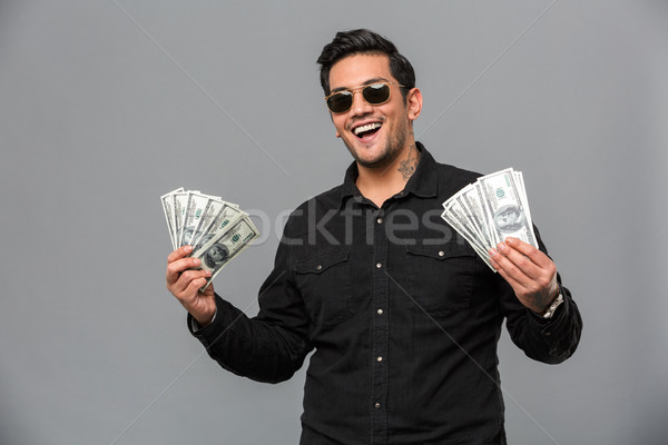 Foto stock: Animado · jovem · homem · bonito · dinheiro · foto