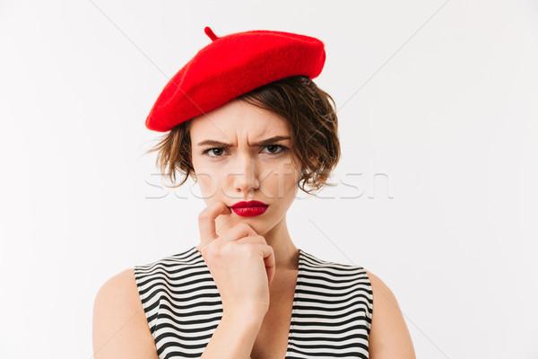 портрет расстраивать женщину красный берет Сток-фото © deandrobot