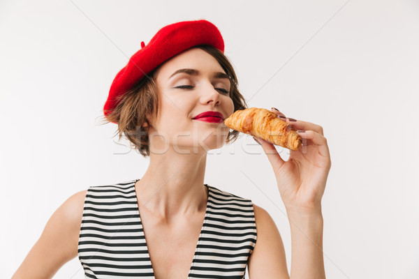 Close up portrait of a satisfied woman wearing red beret Stock photo © deandrobot