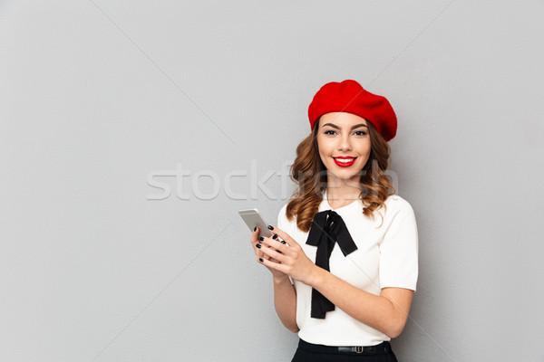 Portret glimlachend schoolmeisje uniform mobiele telefoon Stockfoto © deandrobot