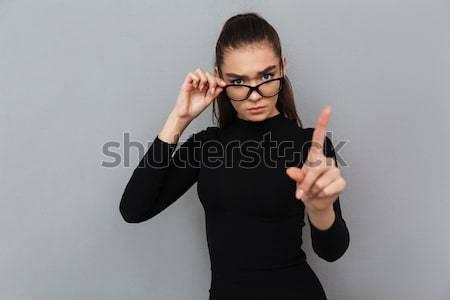 Komoly fiatal elképesztő nő visel szemüveg Stock fotó © deandrobot