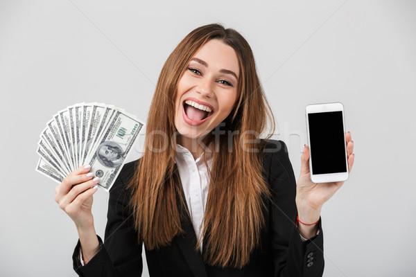 Heureux brunette femme smartphone trésorerie Photo stock © deandrobot