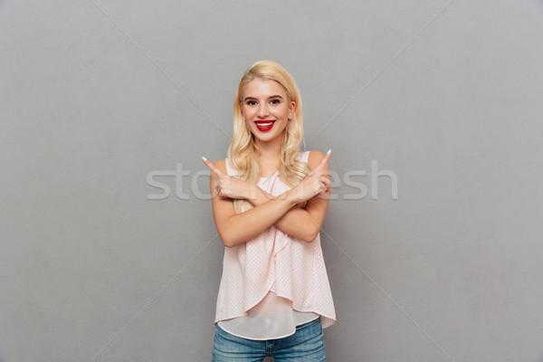 Portrait of a joyful girl standing Stock photo © deandrobot