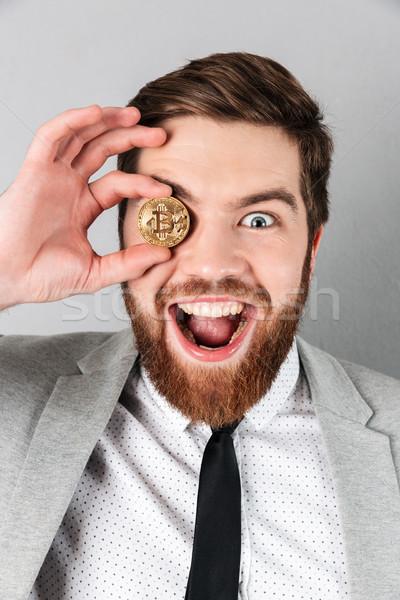 満足した ビジネスマン スーツ bitcoinの ストックフォト © deandrobot