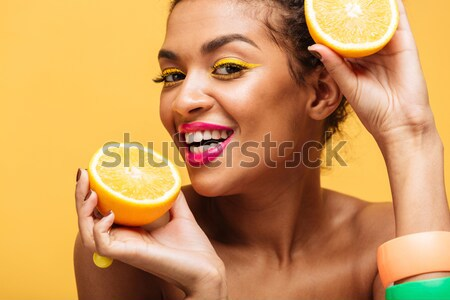 Beauty portrait of an attractive half naked woman Stock photo © deandrobot