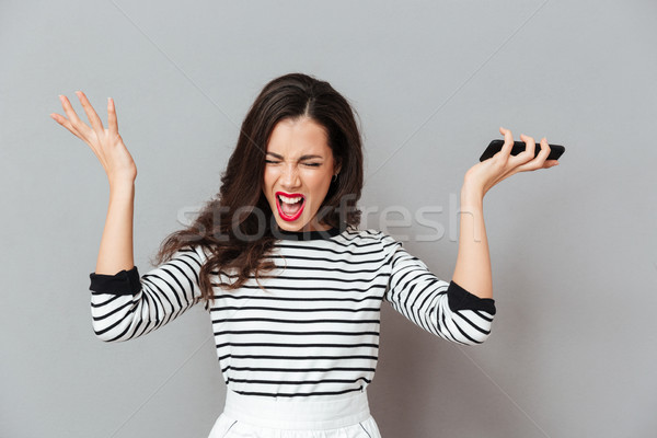 Retrato enojado mujer gritando pie Foto stock © deandrobot