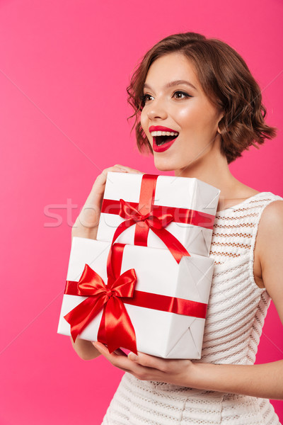 Portrait of an excited girl dressed in dress Stock photo © deandrobot