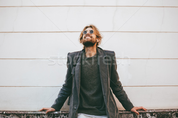 Portrait of a smiling bearded man wearing sunglasses Stock photo © deandrobot