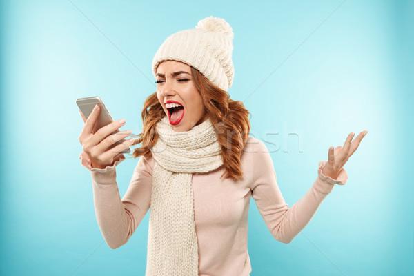 Portré mérges dühös lány kalap sál Stock fotó © deandrobot