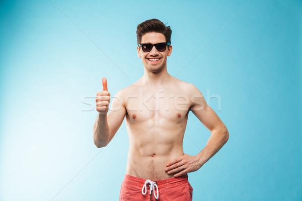 Portre gülen genç gömleksiz adam yüzme Stok fotoğraf © deandrobot
