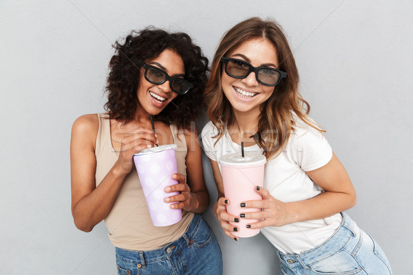 Portrait of two happy young women in 3d glasses Stock photo © deandrobot