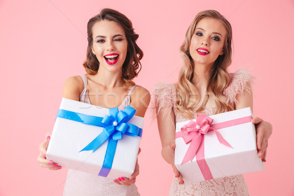 Two cheerful women in dresses having fun together Stock photo © deandrobot