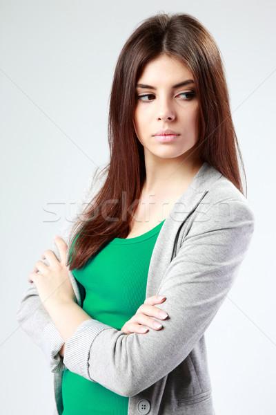 Mujer pie armas doblado gris Foto stock © deandrobot