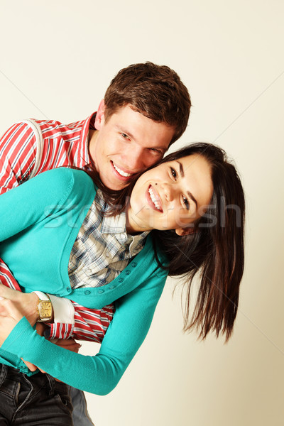 Smiling young couple isolated Stock photo © deandrobot