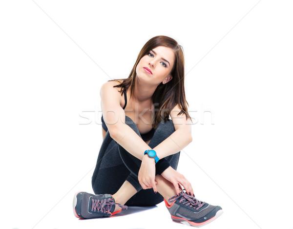 Sérieux femme de remise en forme étage isolé blanche Photo stock © deandrobot