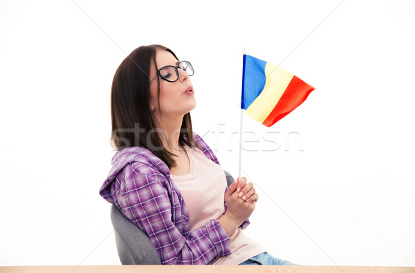 Young woman blowing on the french flag Stock photo © deandrobot