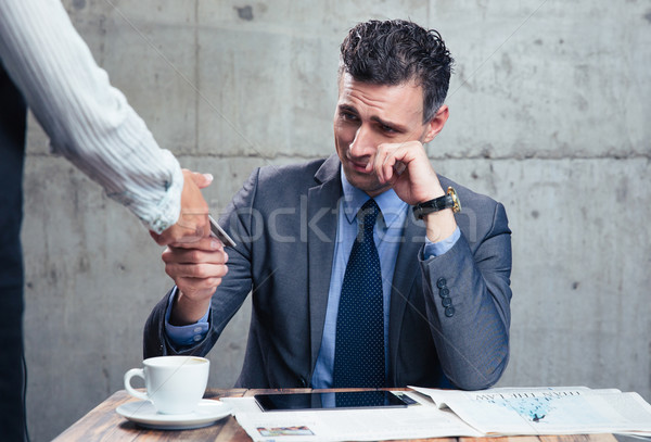 Waitress giving bank card to upset man Stock photo © deandrobot