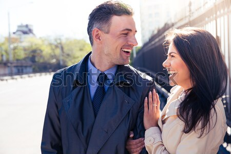 Portrait of a young laughing couple outdoors Stock photo © deandrobot