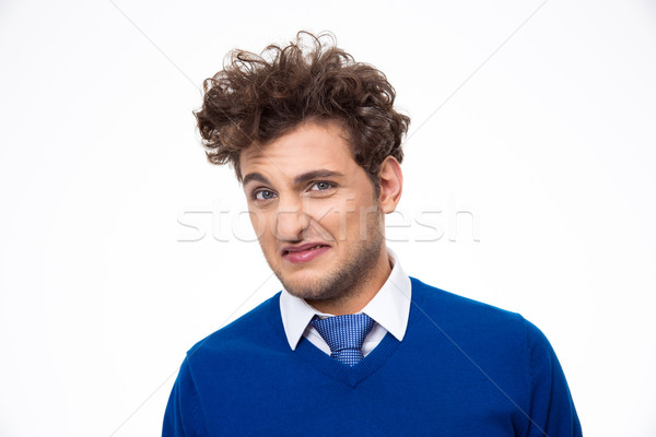 Young man expressing disgust over white background Stock photo © deandrobot
