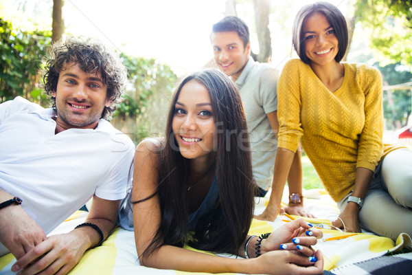 Friends resting outdoors in campus Stock photo © deandrobot