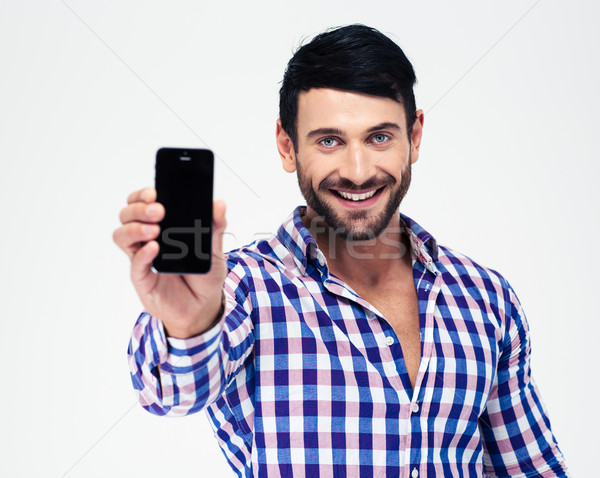 Smiling man showing blank smartphone screen Stock photo © deandrobot