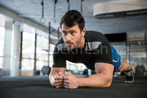 Athlet making static exercise Stock photo © deandrobot