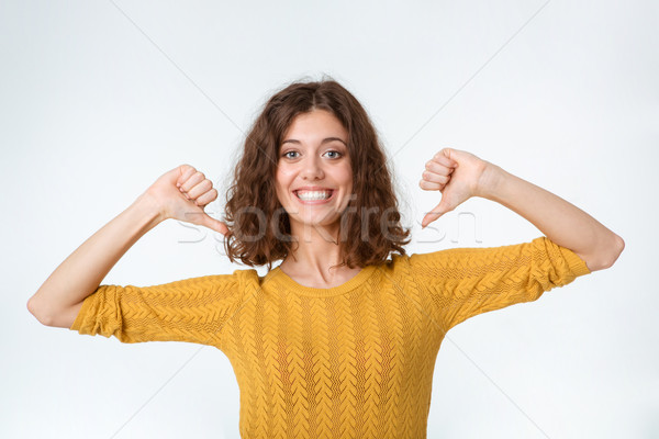 Smiling woman pointing fingers on herself Stock photo © deandrobot
