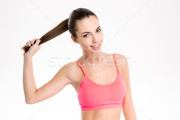 Zabawny wesoły fitness dziewczyna długie włosy Zdjęcia stock © deandrobot