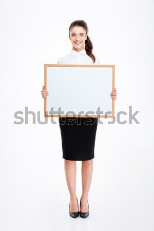 Fitness girl holding blank board and looking on it  Stock photo © deandrobot