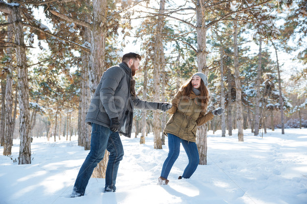 Couple walking in the winter park Stock photo © deandrobot