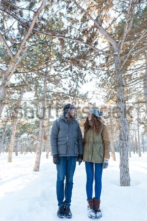 Joyful woman thowing snowballs in handsome man  Stock photo © deandrobot