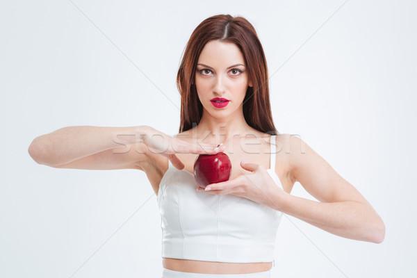 Mujer hermosa manzana roja aislado blanco nina Foto stock © deandrobot
