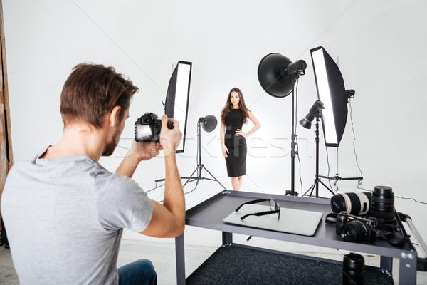 Man shooting female model in studio Stock photo © deandrobot