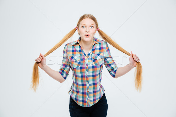 Beautiful woman holding her ponytail Stock photo © deandrobot