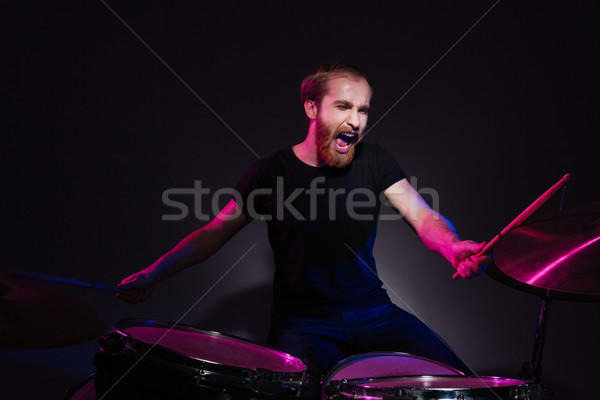 Musician playing the drums Stock photo © deandrobot