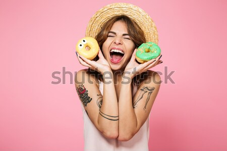 Closeup of happy funny young woman with marmalade candies  Stock photo © deandrobot