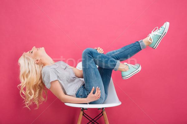 Vonzó nő szórakozás szék rózsaszín nő boldog Stock fotó © deandrobot