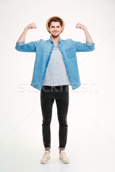 Photo stock: Heureux · élégant · jeune · homme · permanent · biceps