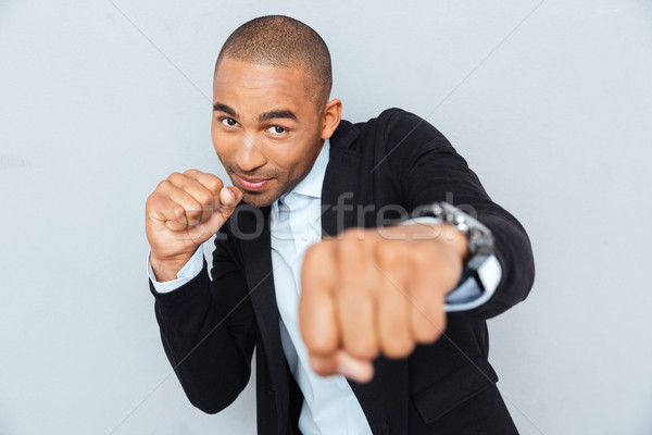 Stock photo: Young businessman standing in boxer position