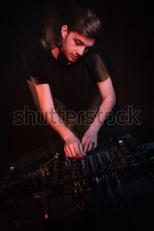 Dj using laptop and playing music Stock photo © deandrobot