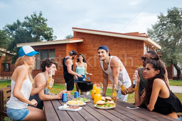 группа молодые друзей пикника Сток-фото © deandrobot