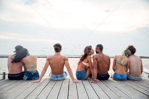 Ver de volta casais sessão pier feliz Foto stock © deandrobot