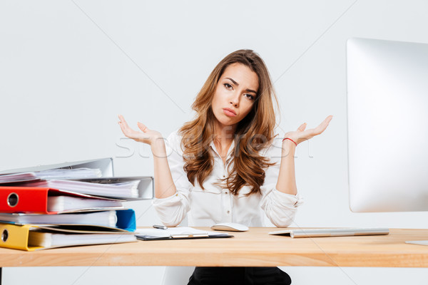 Young confused beautiful businesswoman shrugging shoulders Stock photo © deandrobot