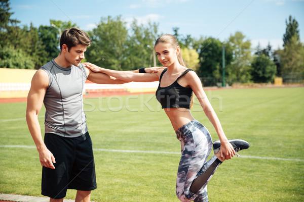 Vrouw atleet permanente personal trainer stadion Stockfoto © deandrobot
